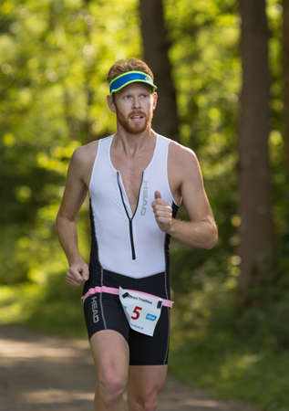 exerted: MORKO SWEDEN - AUG 29: Triathlon for both exercisers and professional exerted on August 29 on an island in Sweden.