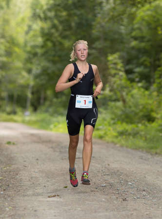 exerted: MORKO SWEDEN - AUG 29 2015: Triathlon for both exercisers and professional exerted on August 29 on an island in Sweden. Christina Hultman.