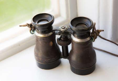 antique binoculars: A beautiful old binoculars, placed on a windowsill in a Swedish old castle