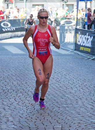 peron: STOCKHOLM - AUG 22: Women ITU World Triathlon event Aug 22 2015. Woman running in Old town. Peron Gaia.