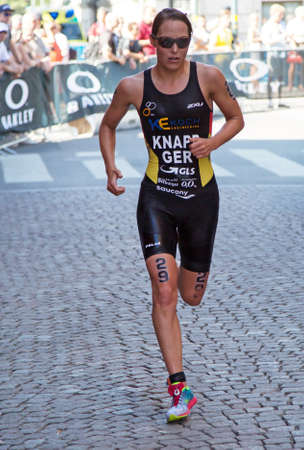 anja: STOCKHOLM - AUG 22: Women ITU World Triathlon event Aug 22 2015. Woman running in Old town.Knapp Anja (GER)