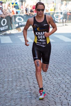 STOCKHOLM - AUG 22: Women ITU World Triathlon event Aug 22 2015. Woman running in Old town.Knapp Anja (GER)