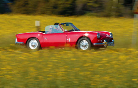 british touring car: Trosa Sweden 5 June 2014. TRIUMPH SPITFIRE 4, model in 1963. Towards the small town of Trosa in Sweden. Editorial