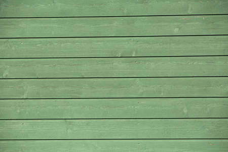 painted wood: Green painted wood panel.