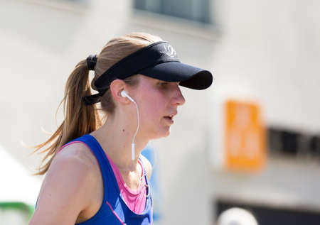 powe: STOCKHOLM SWEDEN  June 4, 2016. A female athlete in the race Stockholm Marathon.