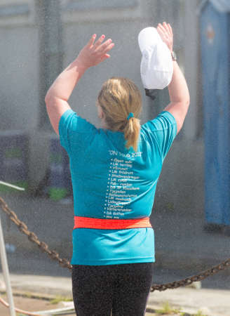cool off: STOCKHOLM SWEDEN 4 JUNE 2016. A female runners take the opportunity to stand under the shower and cool off.