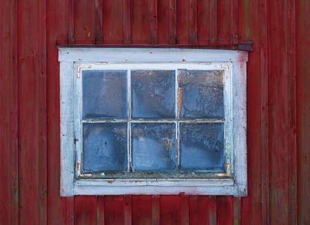 worn: Old worn window in a barn,