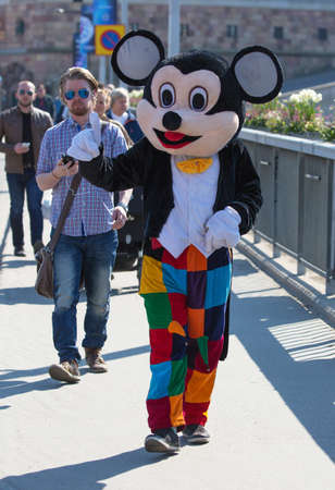 beggars: STOCKHOLM Sweden 4 May, 2016. Beggars dressed as Mickey Mouse. Editorial