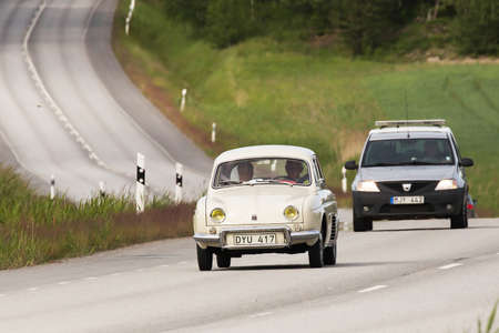 r fine: TULLGARN SWEDEN, 9 JULY 2016. RENAULT R 1090 DAUPHINE year 1961. A ride in the countryside in fine car a beautiful summer day.