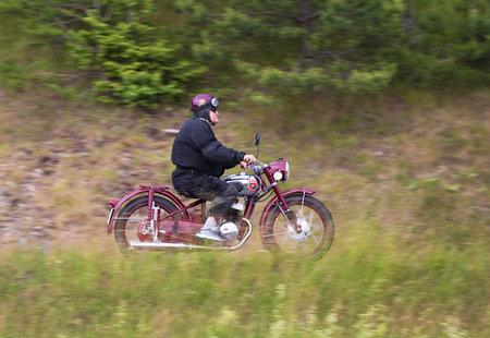 joyride: TROSA SWEDEN 23 June 2016. Elderly man proudly driving his fine old motorcycle of the mark FRAM.