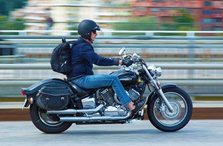 chrome man: STOCKHOLM SWEDEN July 15 2015. Man on motorcycle in Stockholm Editorial