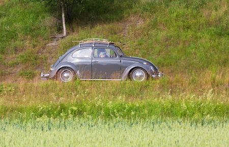 joyride: TROSA SWEDEN June 23 2016. VOLKSWAGEN 1200 LIM 114X. model year 1963. Dark gray.