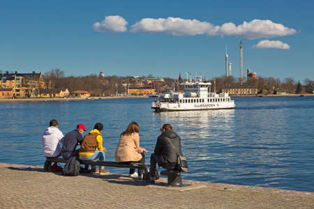 dormant: STOCKHOLM SWEDEN 11 April 2016. Dormant people sitting on a bench in Stockholm.