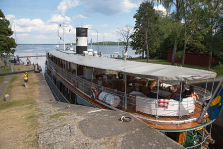 interconnected: MOTALA SWEDEN July 25, 2016. Borenshults. The canals second largest locks. It consists of five interconnected locks and is a major sights in Motala. The lock staircase total drop height is 15.3 meters.
