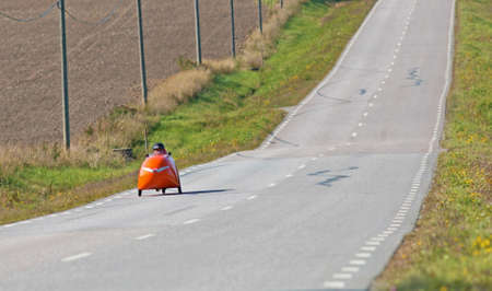MORKO SWEDEN, September 18, 2014, biker on tour in a velomobiel. A man on a bike ride in an unusual vehicle.