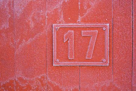 House number seventeen on a facade Stock Photo