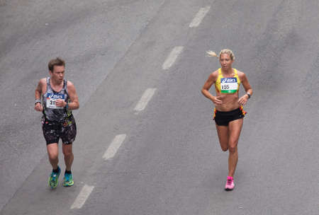 tiresome: STOCKHOLM SWEDEN 3 June 2017. Stockholm Marathon. A tired male participant is passed by a strong woman.