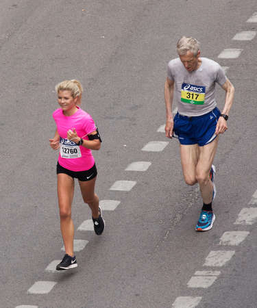 tiresome: STOCKHOLM SWEDEN 3 June 2017. Stockholm Marathon. Young female participant and elderly male participant. Editorial