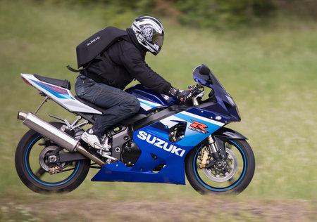 TROSA SWEDEN June 22, 2017. Suzuki motorcycle driving at high speed. Editorial