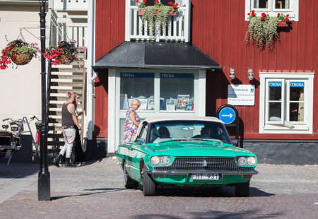 thunderbird: TROSA SWEDEN July 20, 2017. Ford Thunderbird year 1966. Driving in the small idyllic city of Trosa in Sweden.