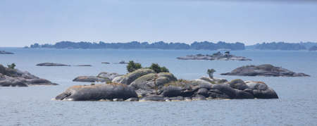 Stockholm archipelago with small and large islands Photographed from a boat.