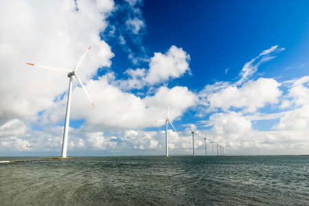 numerous: Numerous wind turbines standing in the sea on the Danish coast Stock Photo