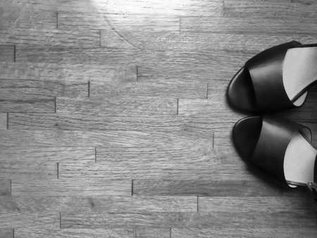 Pair of womans shoes on a wooden floor