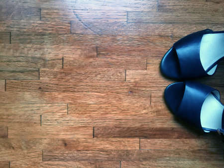 womans: Pair of womans shoes on a wooden floor colored Stock Photo
