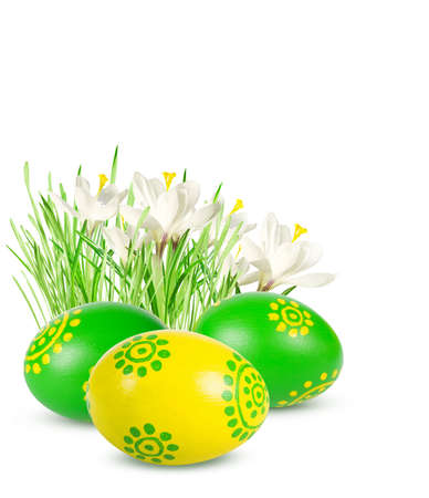Hand painted Easter eggs and flowers isolated on white background  photo