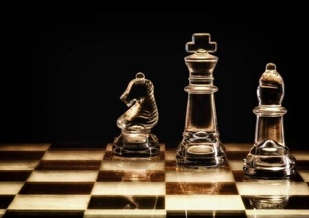 Stylised chess pieces on chess board.