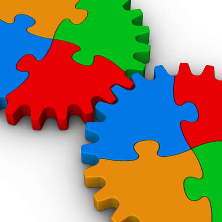 two gears of colorful jigsaw puzzles on white background photo
