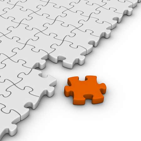 gray jigsaw puzzles with one orange piece Standard-Bild
