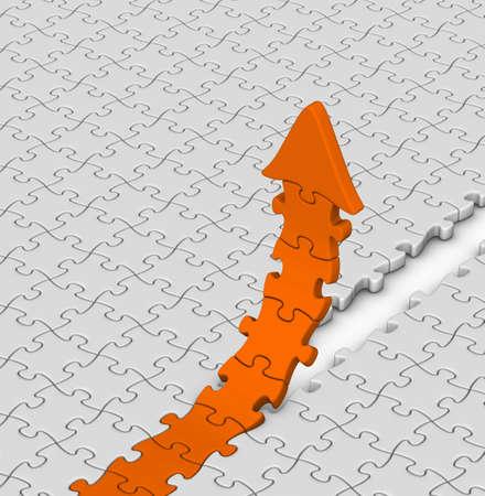 orange jigsaw puzzles arrow on gray background photo