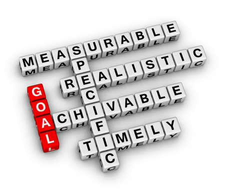 timely: goal setting cubes crossword puzzle Stock Photo