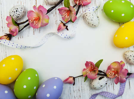 easter background with easter eggs, ribbon and flowers