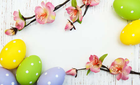 easter background with easter eggs and flowers 写真素材