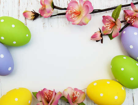 easter background with easter eggs and flowers Stock Photo