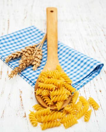fusilli: italian fusilli pasta on a wooden spoon