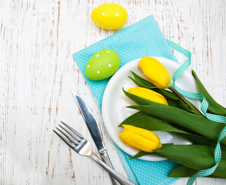 Easter table setting with easter eggs and  tulips Imagens - 38235185