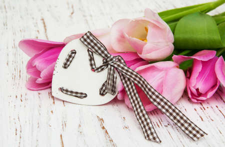 bouquet of pink tulips  on a wooden background photo
