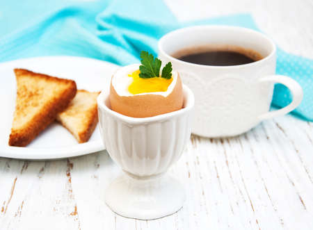 boiled eggs for breakfast on a old wooden table photo