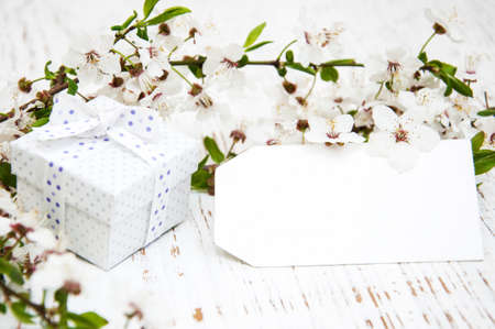 Spring cherry blossom,  gift box and card on a wooden background Imagens