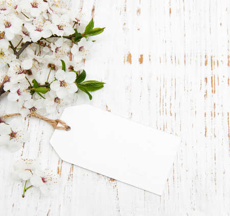 spring cherry blossom with card on a wooden background