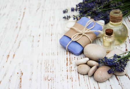 Spa products and lavender flowers on a old wooden background Archivio Fotografico