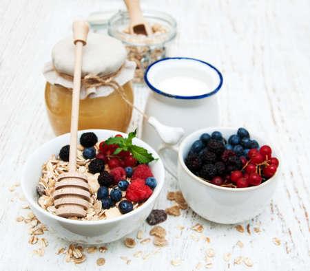 mleko: breakfast with fresh berries, muesli, honey and milk