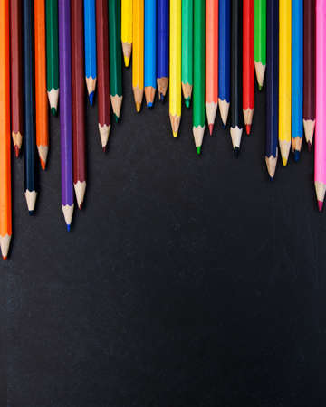 color pencils: Color pencils set on a blackboard background