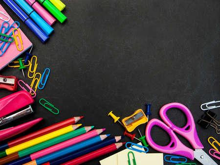 teaching crayons: school supplies on a school   black board