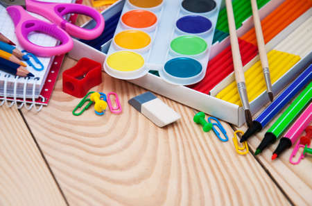 teaching crayons: School supplies on a old wooden background Stock Photo