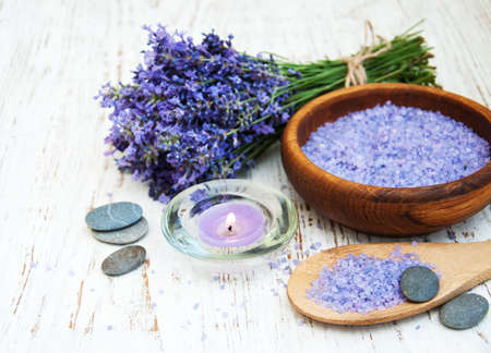 stone background: Lavender, sea salt and candle on a wooden background Stock Photo