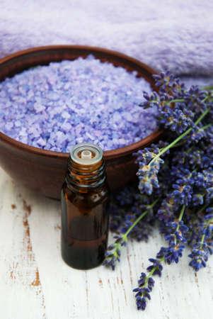 lavender oil with bath salt and fresh lavender on a old wooden background Banque d'images